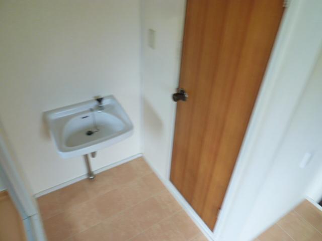 メゾンカンコー 106号室の洗面所